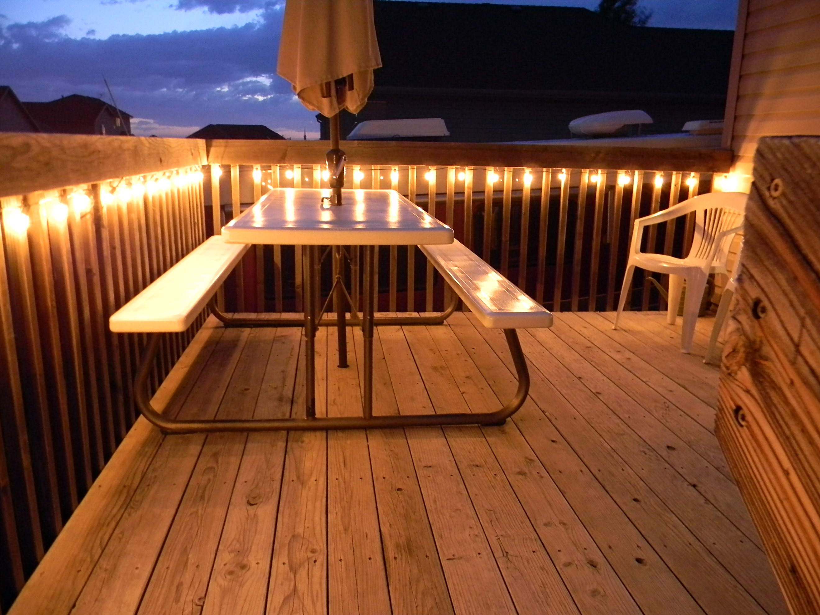 Light up the night deck lighting ideas cedar works for Outside decking material